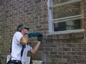 Jason installs hurricane shutter protection.